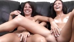 Two naked young sexy chicks are playing with their sweet vaginas