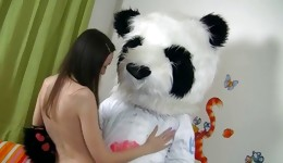 Fabulous brunette goddess riding enormous panda's joystick
