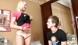 Sweet looking blonde babe is getting naked in front of him and fucks