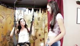 Two playful girls having fun fingering and licking also using a swing