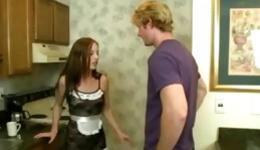 Guy is seduced by his young and attractive maid and she gives him blowjob in the kitchen