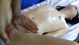 Playful brunette all covered in oil is getting her pussy smashed inside
