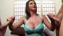 Hot beautiful brunette is on her knees rubbing on two fat dicks