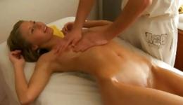 Hot naked couple on massage bed having fun pleasuring each other